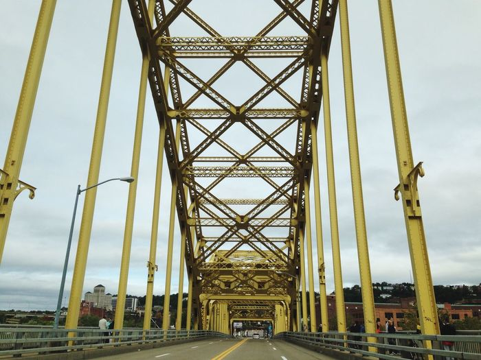 Low angle view of david mccullough bridge against sky