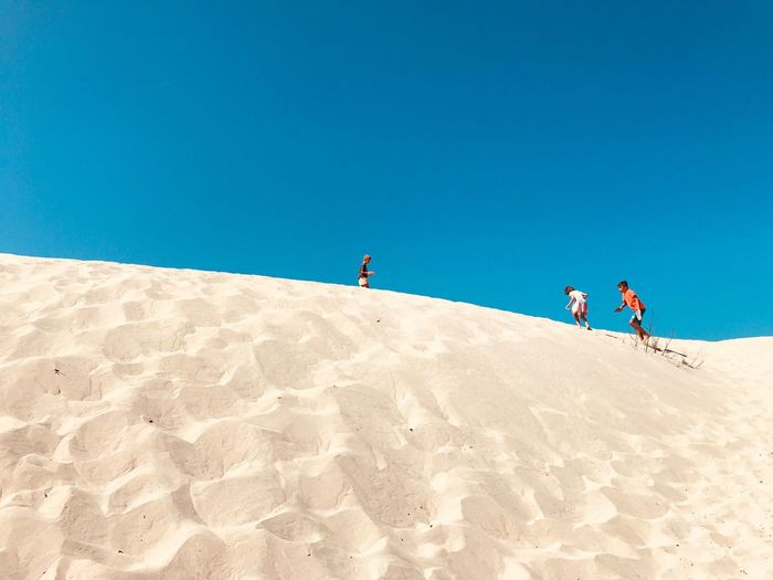 Dune Sky Sand Land Nature Clear Sky Men Blue Landscape Travel Scenics - Nature Lifestyles Beauty In Nature Group Of People Sand Dune Desert Day Holiday