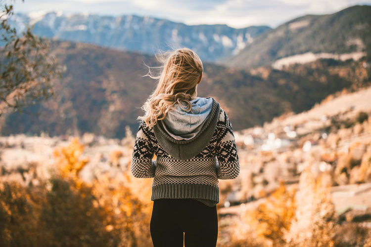 Blonde Fashion Females Adult Adults Only Autumn Beauty In Nature Blond Hair Day Focus On Foreground Mountain Nature One Person One Woman Only One Young Woman Only Only Women Outdoors People Real People Rear View Scenics Sky Standing Women Young Adult
