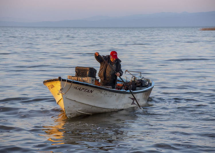 Nautical Vessel Water Transportation Mode Of Transportation Sea Real People Waterfront Nature Men Travel Day Sky Occupation Lifestyles Scenics - Nature People Outdoors Fisherman Fishing Boat