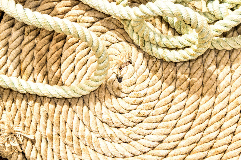 Close-up of ropes during sunny day