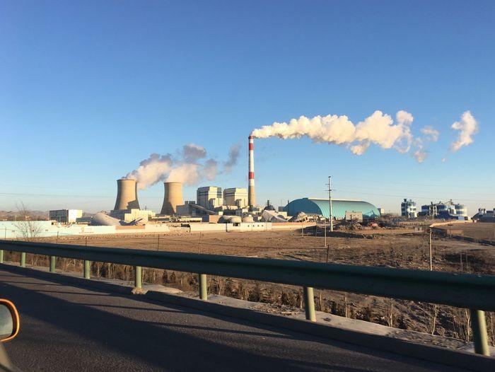 Industrial Buildings Against Blue Sky