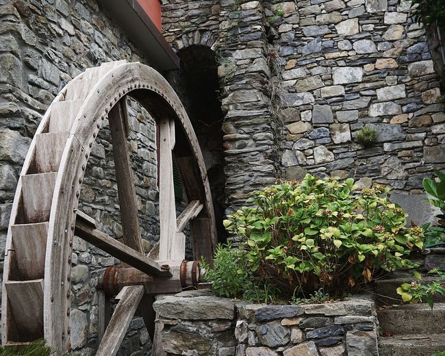 Watermill Water Wheel Architecture Built Structure Building Exterior Stone Wall Traditional Building Brick Wall Archway Wall Brick Ivy Historic Past Arched Plant Life