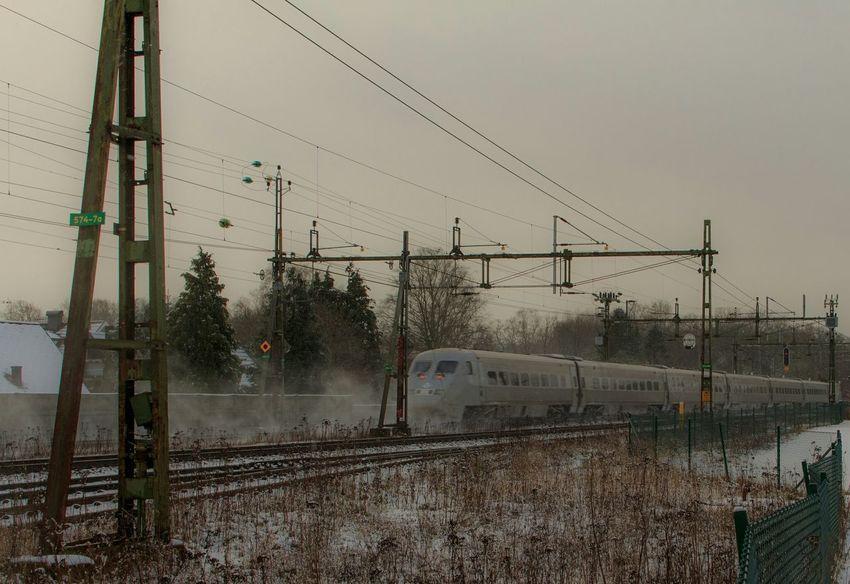 Train roaring by. Sweden Skåne Winter Sky Train