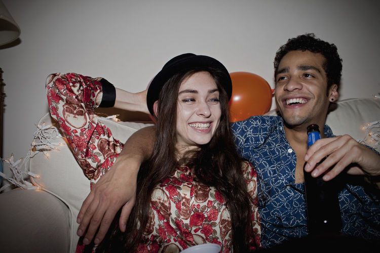 Portrait of smiling young couple sitting