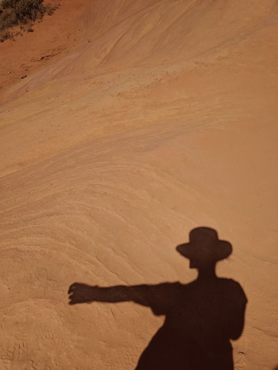 Shadow of man on sand