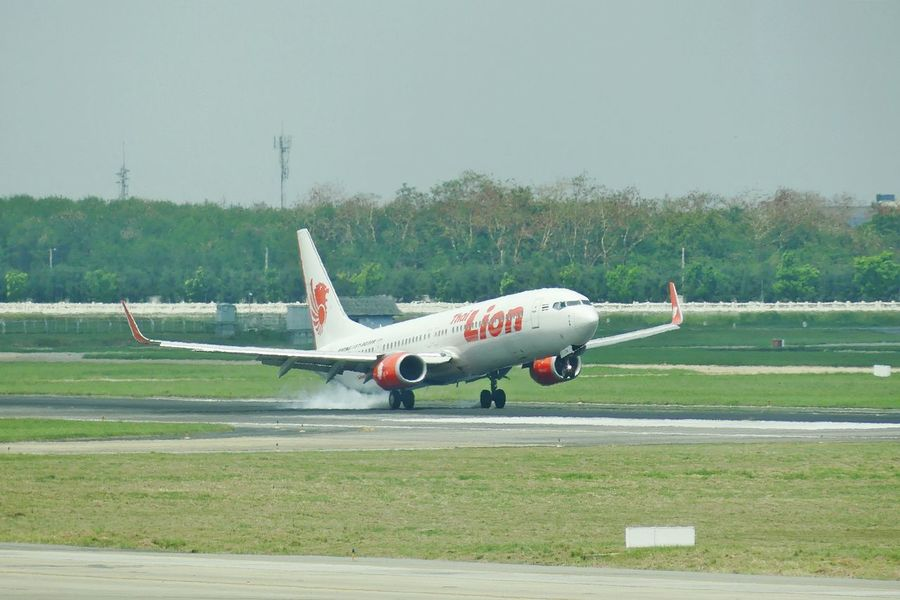 Bangkok, Thailand - April 14,2017 : Thai Lion Air Touch Down on runway at Don Mueang International Airport on April 14, 2017. Thai Lion Air is a Thai low-cost airline. Air Vehicle Airplane Airport Airport Runway Clear Sky Day Fight Flying Landing Landing - Touching Down Motion Nature News Airplane No People Outdoors Propeller Airplane Runway Sky Sky And Clouds Takeoff ✈ Thai Airline Passenger Thai Lion Air Transportation สนามบินดอนเมือง