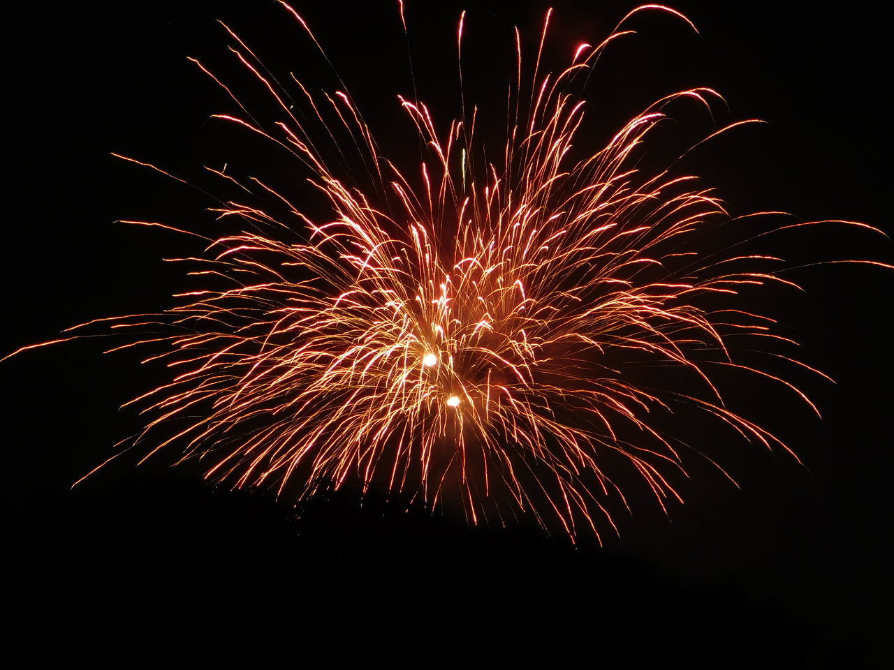 motion, illuminated, firework, night, glowing, long exposure, celebration, event, arts culture and entertainment, firework display, sky, blurred motion, exploding, no people, nature, low angle view, firework - man made object, light, outdoors, sparks