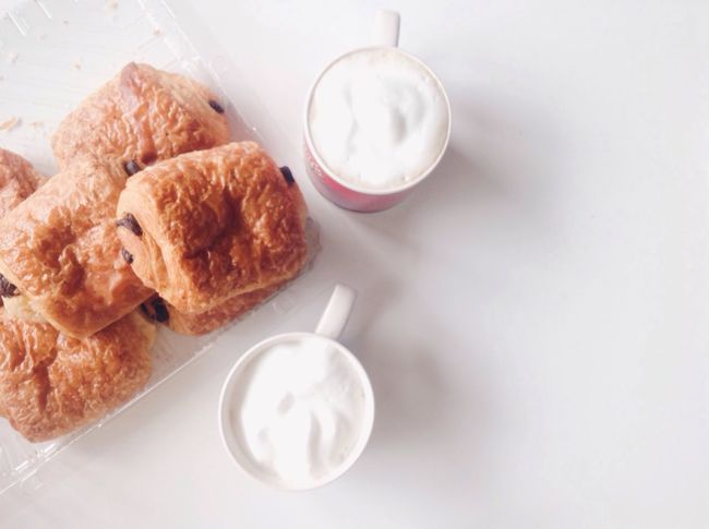 Food And Drink Milk Drink Food Sweet Food High Angle View Croissant No People Frothy Drink Red Chocolate Temptation Indulgence Baked Minimalist Baked Pastry Item Pain Au Chocolat White Background Coffee Cappuccino Goûter Ready-to-eat Styled Photos Lifestyle Photography