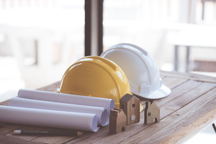 Table Indoors  Focus On Foreground Wood - Material Close-up No People Still Life Technology Hardhat  White Color Day Equipment Food And Drink Helmet Protection Headwear Connection Industry Security Rolled Up