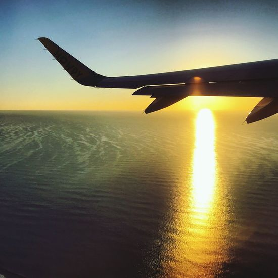 Airplane Sunset Sky Transportation Flying Sea Nature Silhouette Journey Aircraft Wing Beauty In Nature
