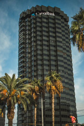 Barcelona, Spain - 09.11.2018 National day of Catalunya (Diada de Cataluña) Arquitecture Apartment Architecture Bank Building Building Exterior Built Structure City Cloud - Sky Day Growth Low Angle View Nature No People Office Building Exterior Outdoors Palm Leaf Palm Tree Plant Sky Skyscraper Tall - High Tower Tree Tropical Climate