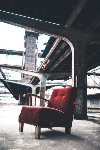 Empty Chair Against Bridge In City