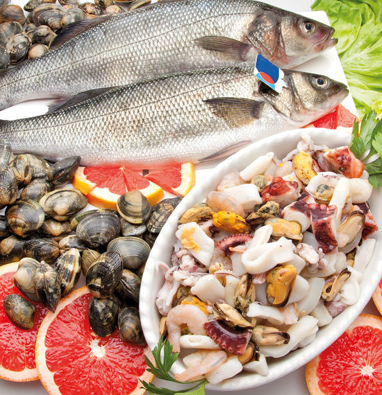 Composition of sea bass, mixed seafood and clams with tomato and rose pompelmo Close-up Day Fish Food Food And Drink Freshness Healthy Eating Indoors  No People Plate Raw Food Ready-to-eat Seafood Variation
