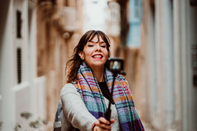 Portrait of smiling woman standing outdoors