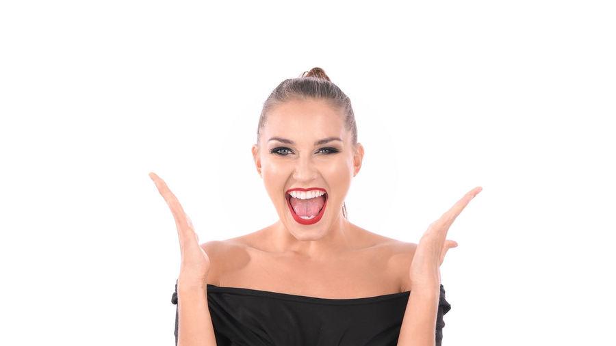 Success concept. Young women are extremely happy on a white background. Achievement Amuse Attractive Beautiful Woman Casual Business Caucasian Girl Celebrating Celebration Cheer Up Cheerful Enjoy Excellent Excited Expression Face Treatment Fashion Model Fill Happiness Fun Gesture Happy Time Humored Isolated Joy Lady LIBERATE Lifestyle Lift Arm Makeup Cosmetic Natured One People Perfect Positive Raise Hand Sanguine Scream Shy Smiling Stripes Success Successful Triumph Unfettered Victory White Background Win Winner WOW Yeah Sure Yes Young Adult