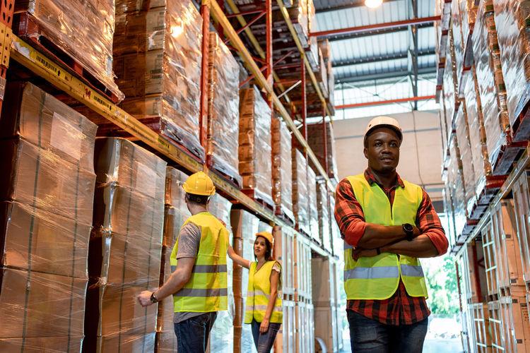 Full length of men working on building