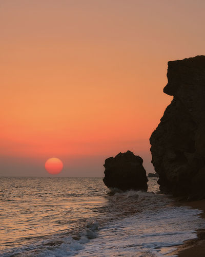 Sunset Sea Beach Rock - Object Rock Formation Horizon Over Water Sun Beauty In Nature Nature Dramatic Sky Landscape Cliff Red Scenics Sunlight Sunny Water No People Travel Destinations Sky