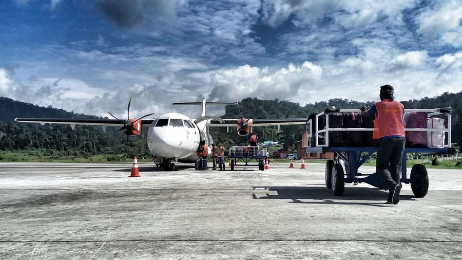Transportation Mode Of Transport Cloud - Sky Sky Men Aircraft Aviation Ground Handling Ground Crewin Raja Ampat Papua Indonesia