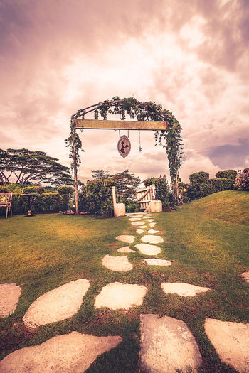 Garden with a gate Cloudy Gate Travel Beauty In Nature Cloud - Sky Clouds Day Grass Nature No People Outdoors Sky Structure Sunlight Sunset Travel Destinations Tree