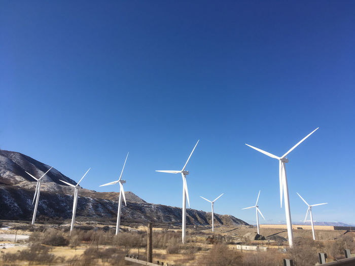 Giant wind turbines create clean, renewable energy. Blue skies and mountains. Spanish Fork Canyon, Spanish Fork, Utah, USA. Utah green energy production. Alternative Energy Beauty In Nature Clean Energy Clean Environment Clear Sky Day Enviormental Issues Fuel And Power Generation Green Energy Green Environment Industrial Windmill Nature No People Outdoors Sky Spanish Fork Canyon Spanish Fork Utah Spanish Fork,ut Wind Energy Wind Power Wind Turbine Wind Turbine Wind Turbines Wind Turbines On A Field Windmill