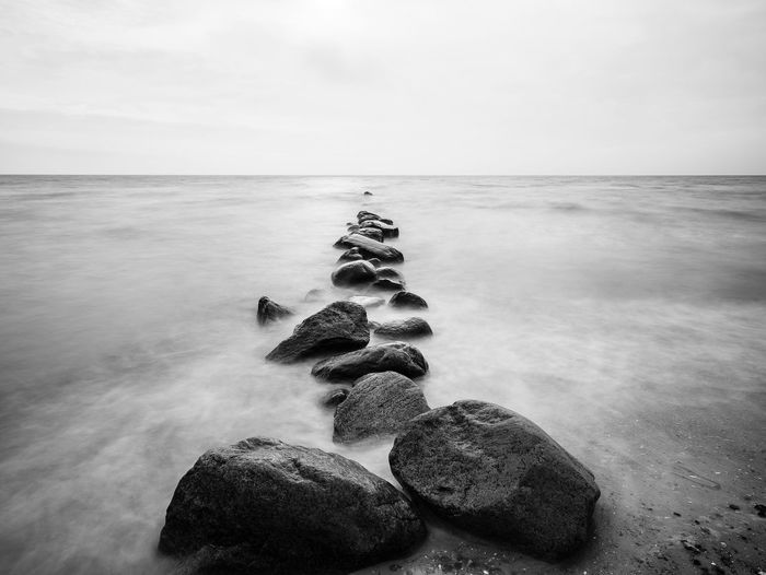 Straight ahead EyeEm Selects EyeEm Best Shots First Eyeem Photo Landscape Seascape Monochrome Blackandwhite Fine Art Photography Beach Baltic Sea Sea Water Sky Horizon Beauty In Nature Beach Horizon Over Water Rock Land Scenics - Nature Nature Solid Tranquility Rock - Object Tranquil Scene No People Day Outdoors Sand Pebble The Great Outdoors - 2018 EyeEm Awards