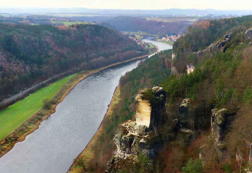 View of the Elbe river and the Wartturm rocks, major landmark of the Saxon Switzerland National Park. Germany Above Aerial View Bastei Beauty In Nature Countryside Day Ebre River Europe Famous Place Forest Germany Landscape Mountain Range Mountains National Park Nature Picturesque Rocky Mountains Saxon Switzerland Saxony Scenery Travel Destinations Valley Wartturm Water