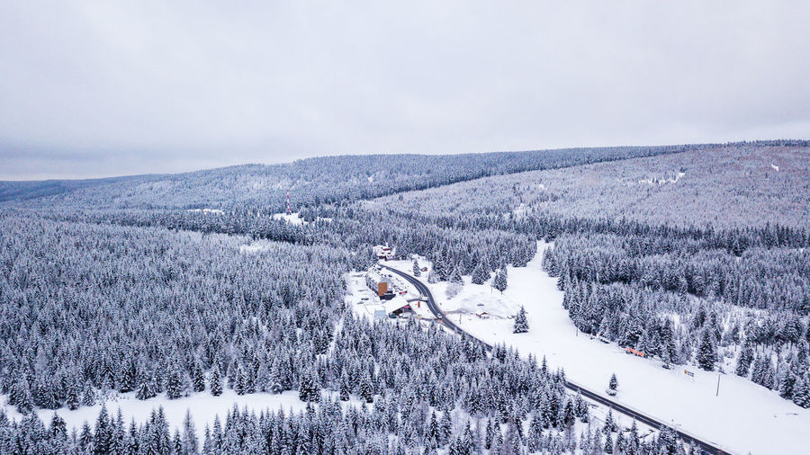 Drone shot of an epic landscape under snow in Poland Drone  Dronephotography Aerial View Ice Poland Road Tree Trees Beauty In Nature Cold Temperature Day Landscape Mountain Nature No People Outdoors Scenics Sky Snow Tranquil Scene Tranquility Travel Destinations Tree Vacations Weather Winter
