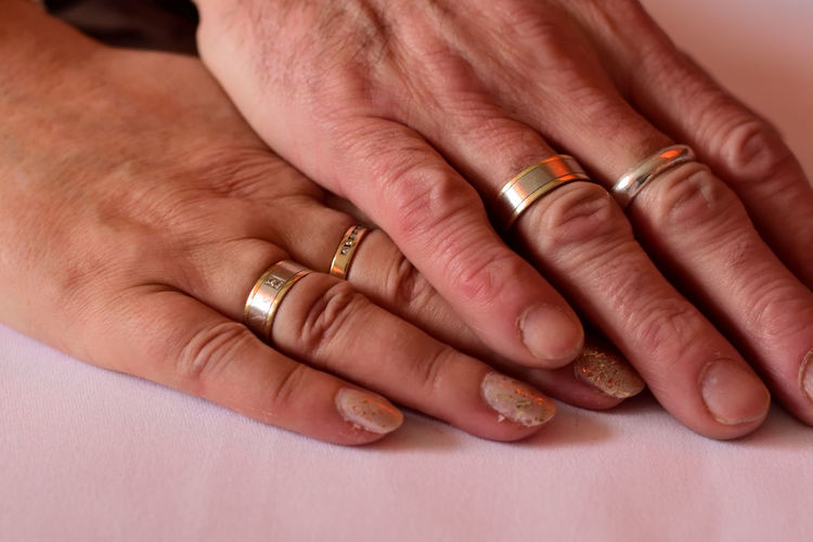 Cropped Image Of Hands Wearing Rings