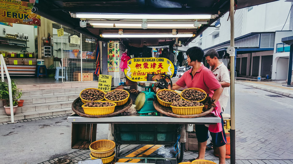 Retail  Food Market Stall Market Store Market Vendor Women Built Structure Full Length Real People Street Food Men Small Business Street Market Vendor Selling City Business Architecture Cultures StreetFoods Hawker Food Hawkers Georgetown Penang Georgetown
