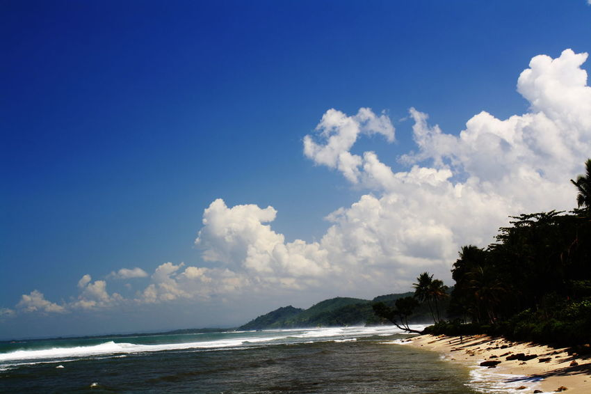 Karapyak Beach-Pangandaran Beach Beauty In Nature Blue Blue Sky Cloud - Sky Day Horizon Over Water Nature No People Outdoors Pangandaran Scenics Sea Sky Tranquil Scene Tranquility Tree Water Wave