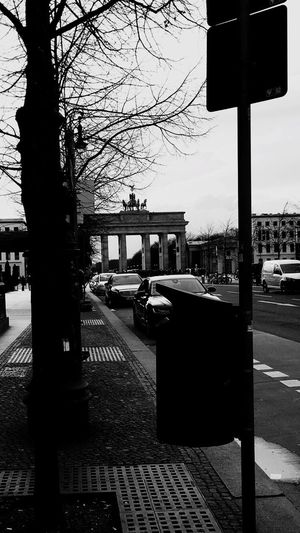 Welcome To Black Street Tree Transportation Car City Building Exterior Built Structure Bare Tree Outdoors Architecture Land Vehicle Day Sky No People Berlin Berlinstagram Berliner Ansichten Berlin Mitte Berlin Photography Brandenburger Tor Trashcan