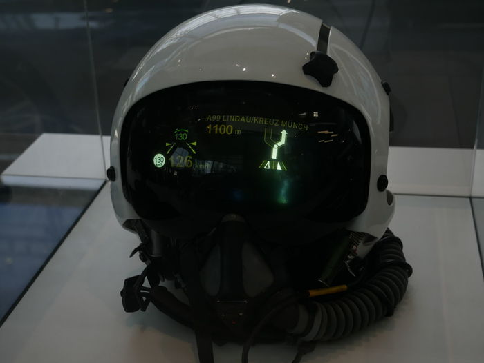 Aerospace Industry Black Color Close-up Communication Connection Digital Camera Focus On Foreground Front View Glass - Material Green Color Headwear Helmet Indoors  Mode Of Transportation No People Photography Themes Reflection Table Technology Transparent Transportation