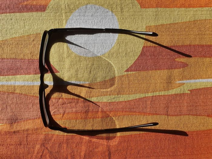 High angle view of sunglasses on table during sunny day