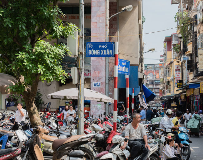 Vietnam, Hanoi - October 21, 2016: Street lane in Hanoi with a lot of town lives Adult Adults Only Architecture Building Exterior City Crowd Day Hanoi Vietnam  Huế Large Group Of People Men Outdoors People Real People Tree Vietnam Women