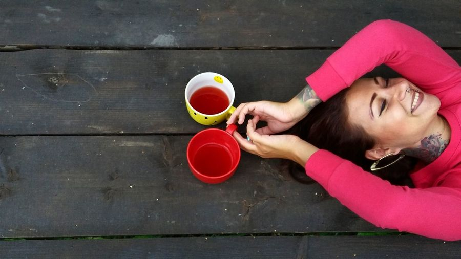 Woman holding mugs