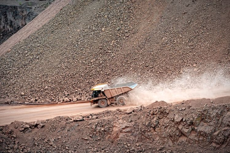 High Angle View Of Dump Truck On Dirt Road
