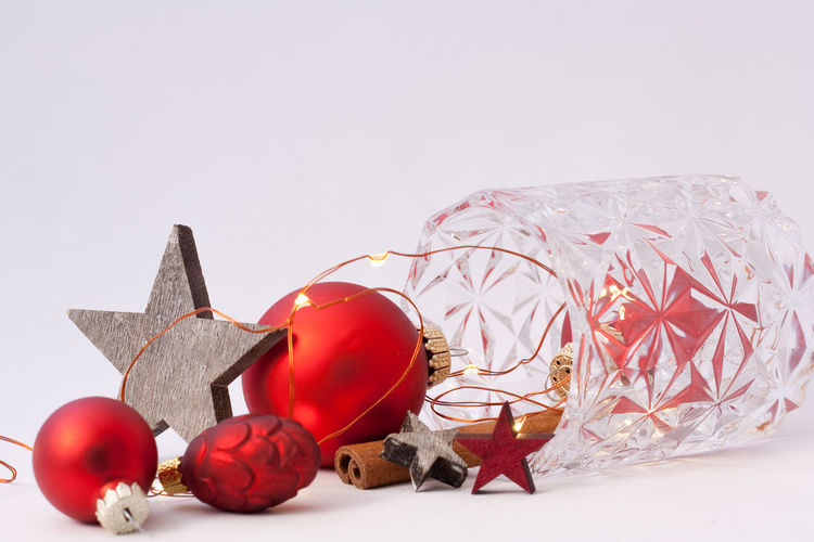 Holiday Celebration Decoration Christmas Red Christmas Decoration Christmas Ornament Holiday - Event Indoors  Still Life Studio Shot No People White Background Close-up Christmas Lights Cinnamon Star Merry Christmas! Copy Space Backgrounds Celebration Lights Ornaments