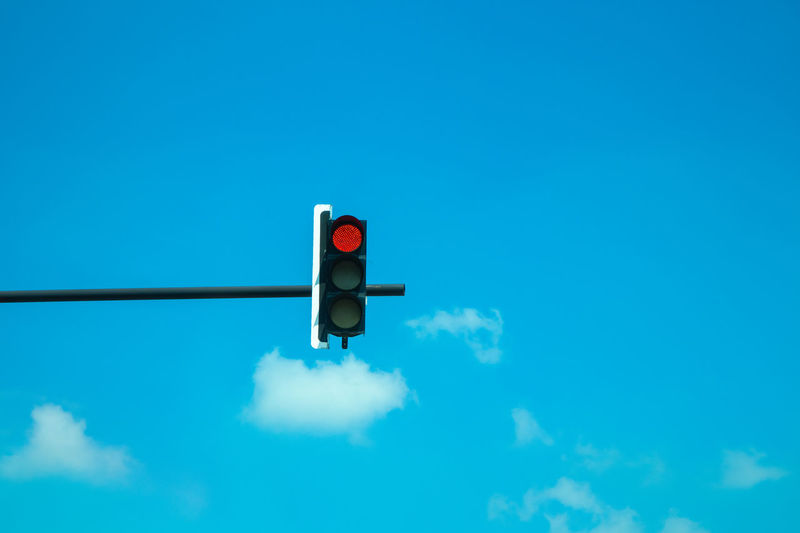 Blue Cloud - Sky Control Day Direction Guidance Light Lighting Equipment Low Angle View Nature No People Outdoors Red Red Light Road Signal Rules Safety Sign Sky Stoplight Transportation