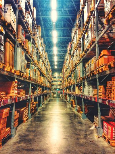 Aisles amidst shelves in warehouse