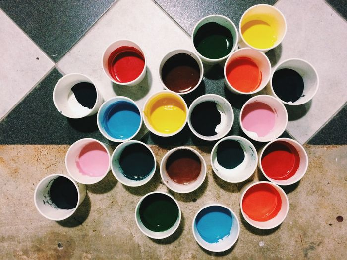 High angle view of multi colored cups
