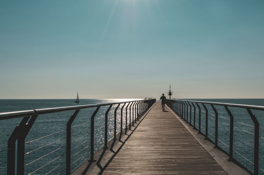 Sky Sea Water Railing Horizon Horizon Over Water Direction Nature Beauty In Nature Scenics - Nature The Way Forward Tranquil Scene Tranquility Pier Clear Sky Architecture Day Sunlight Built Structure No People Diminishing Perspective Outdoors