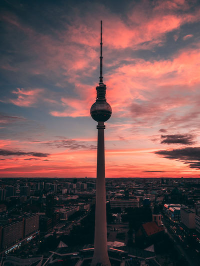 Fernsehturm In City Against Romantic Sky During Sunset