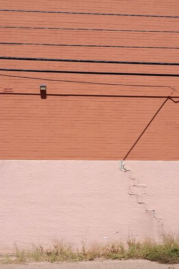 High angle view of telephone pole on wall