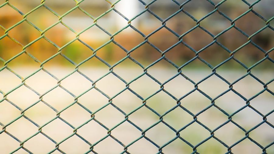 Green mesh fence with sunlight. Fence Mesh Thailand Sunlight Textured  Focus On Foreground Protection Safety Close-up Full Frame Day No People Outdoors Sport Backgrounds