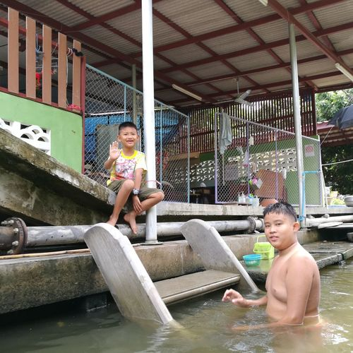 Thailand children smile Person Lifestyles Boys Playing Casual Clothing Full Length Young Adult Person Lifestyles Young Men Leisure Activity Boys Teenage Boys Sitting Playing Teenage Girls Smiling Childhood Cheerful Looking At Camera Confidence  Day Mixed Race Person