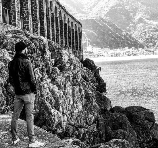 Full length of man looking at sea