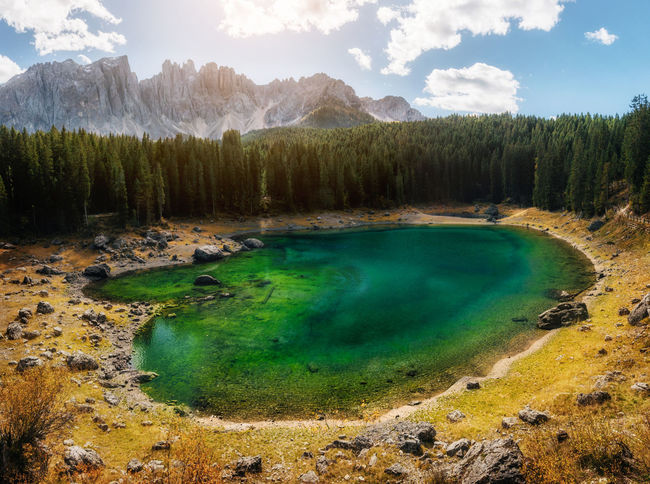 Karersee or Carezza Lake in Dolomites in South Tyrol in autumn at sunset, Italy. Dolomites Dolomites, Italy Mountain View Beauty In Nature Cloud - Sky Idyllic Italy Italy❤️ Lake Land Non-urban Scene Plant Scenics - Nature Sky Tranquil Scene Tranquility Tree Turquoise Colored Water