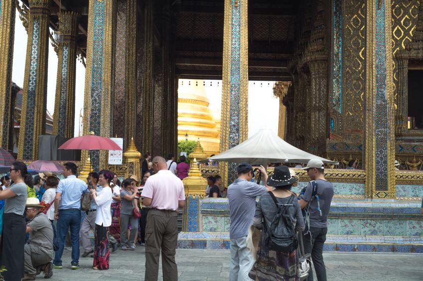 Architecture Day Large Group Of People Men Outdoors People Real People Religion Thailand Bangkok Wat Pra Kaew Tourism Buddha Golden Pagoda Walking Audience Religion Travel China Tourism Retail  Buddha Status Sitedown Lifestyles Brass Buddha Status Retail  City