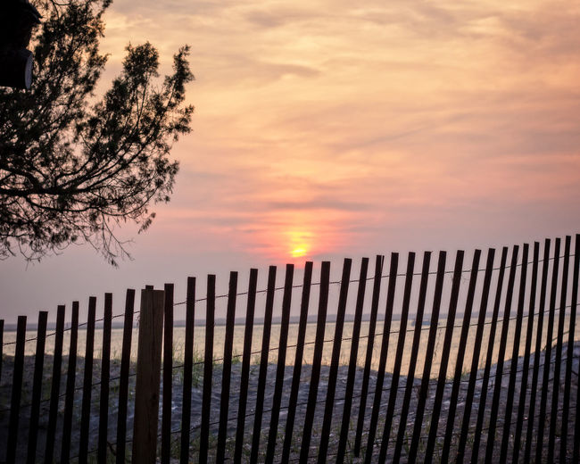 Sunset Behind the Fence Sky Sunset Cloud - Sky Fence Orange Color Nature No People Tree Beauty In Nature Scenics - Nature Tranquility Outdoors Picket Fence